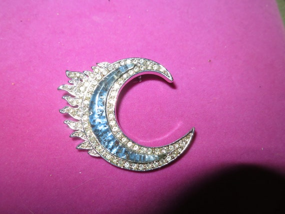 Beautiful vintage BSK Silvertone Clear Crystal & Blue Faux Glass Flame/Crescent  brooch