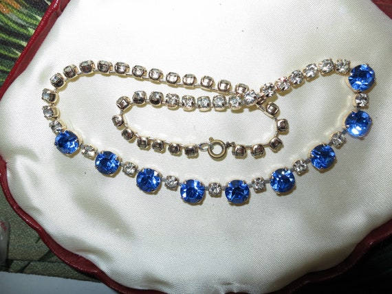 Lovely vintage gold metal sapphire blue and clear rhinestone glass necklace