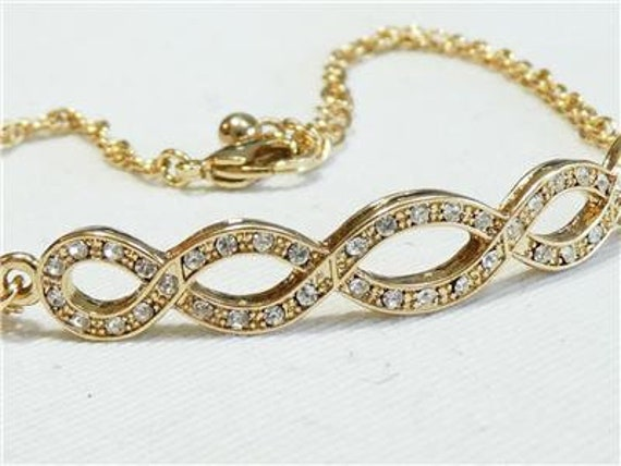 Lovely vintage Gold Plated & Crystal Curved Infinity bracelet
