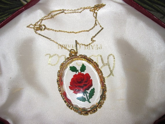 Beautiful vintage gold reverse carved clear rose pendant necklace