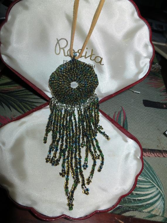 Lovely vintage  beige suede necklace with olive AB glass tassel