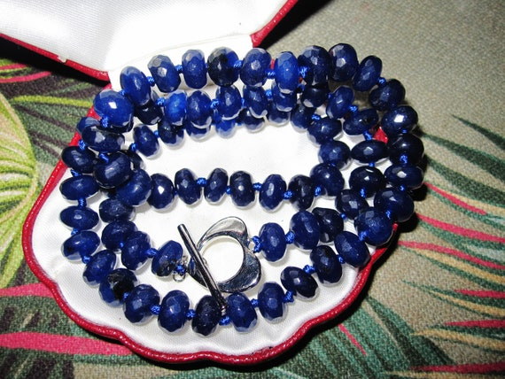 Lovely 8mm faceted and knotted natural blue sapphire necklace