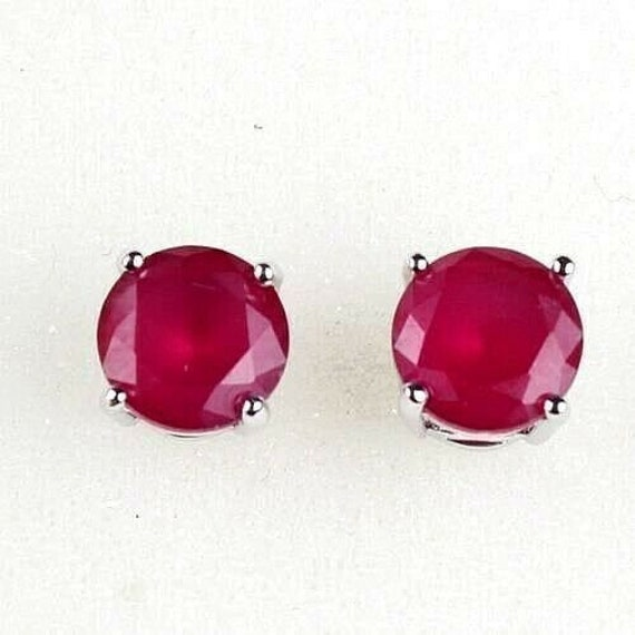 Beautiful pair of 18 white gold filled ruby stud earrings