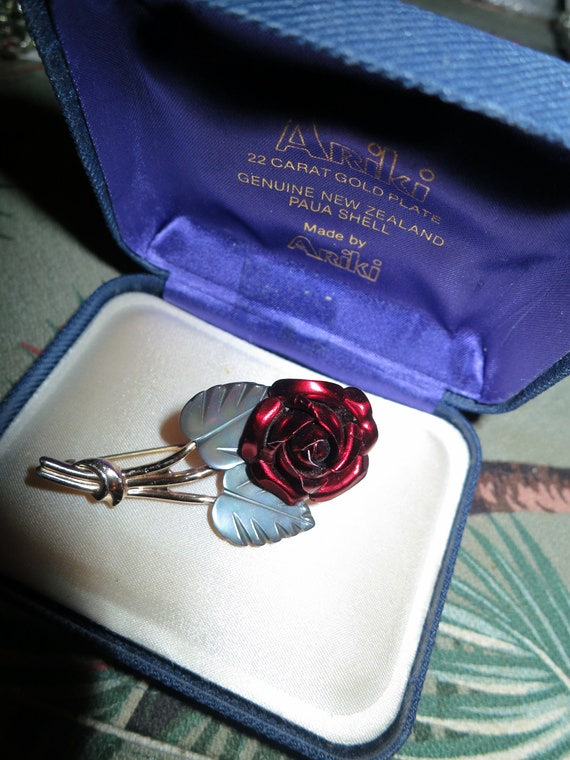 Beautiful vintage goldtone red metal rose with mother of pearl leaves  brooch
