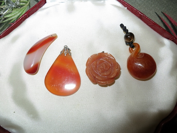Wonderful collection of genuine carnelian carved pendants