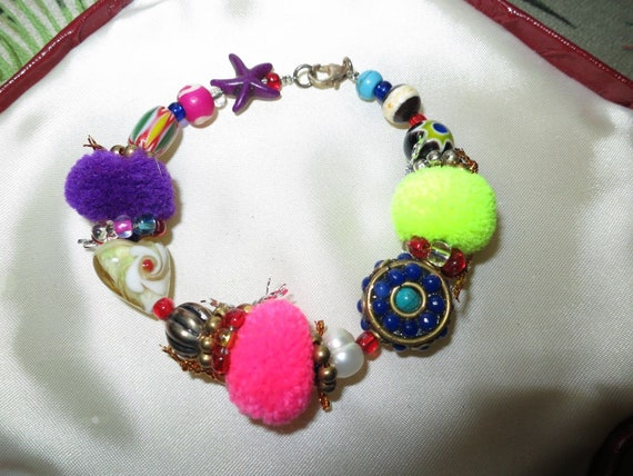 Lovely colourful resort wear holiday pom pom and glass pearl bracelet 7""
