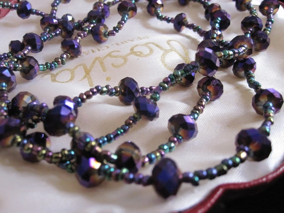 Beautiful vintage purple aurora borealis and seed glass flapper necklace