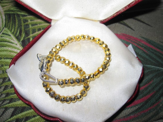 Lovely faceted 4mm gold pyrite  bracelet with sterling silver clasp