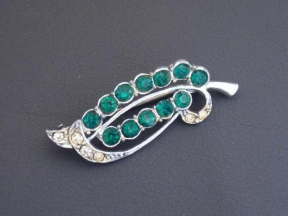 Vintage Small Silvertone and Green  Clear Rhinestone Stylised Feather  brooch