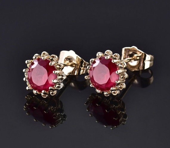 Beautiful 18 gold filled  8mm ruby stud earrings