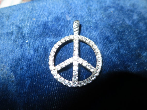 Beautiful Vintage silvertone rhinestone Peace sign pendant