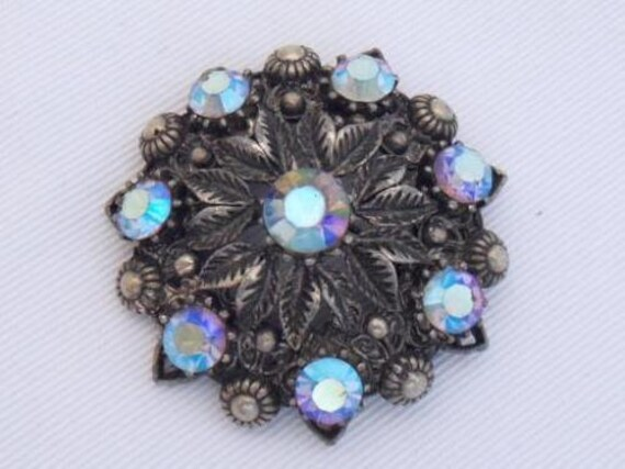 Vintage blackened silvertone blue aurora borealis glass   floral brooch
