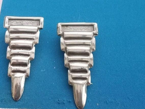 Beautiful pair of vintage Art Deco 1940s chrome metal dress clips