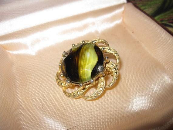Lovely vintage Scottish goldtone fx marcasite  banded olive glass brooch