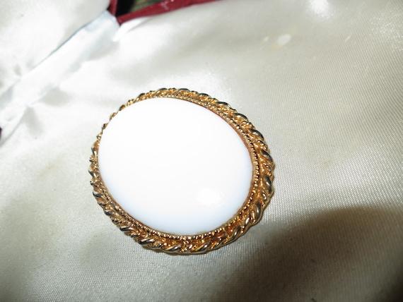 Lovely vintage goldtone framed white glass brooch