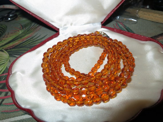 "Beautiful vintage 48"" long amber glass bead flapper necklace"