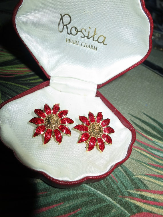 Wonderful vintage pair of sparkly red enamel daisy clip on earrings