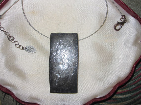 Vintage stylish pewter resin pendant on a silver tone wire necklace
