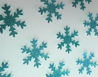 12 flocons turquoise en papier pailleté pour décorer votre table -neige