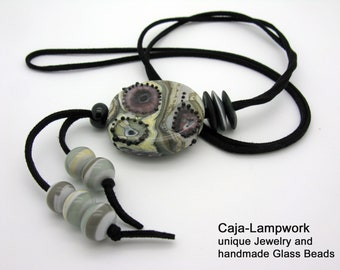 ivory and taupe great color combination in black Noble lampwork necklace with a very large handmade focal bead