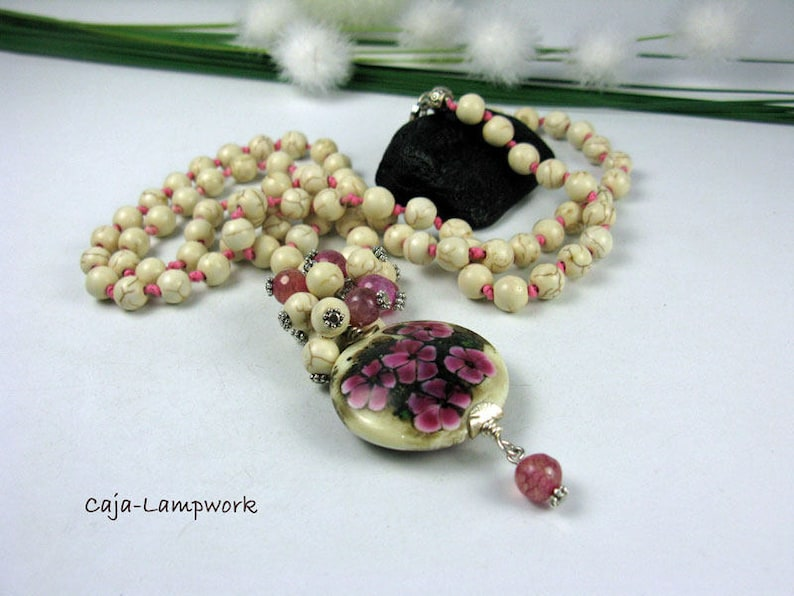 Long chain with very large Lampwork flower bead Howlithperlen knotted