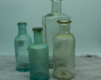 Group of 4 Vintage Glass Bottles - Instant Collection