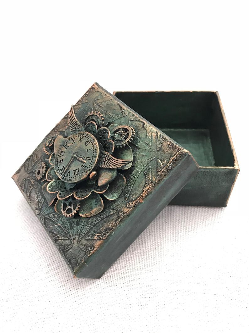 Small mixed media gift box.