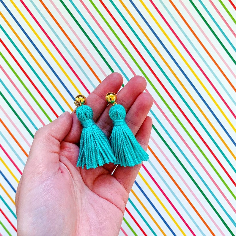 The Lauryn Mini Tassel Earrings on a Gold Stud Mini Tassels Aqua
