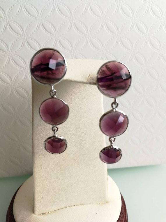 Real stone earrings of amethyst. Ancient earrings.