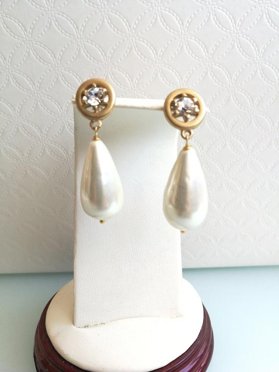 White pearl earrings. Vintage antique earrings. An