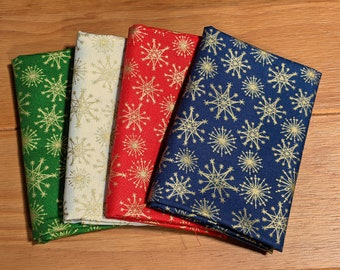 GLD122 Set of Four Fat Quarters - Gold Snowflakes (Metallic on Green, White, Red & Blue background)
