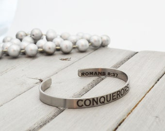 "Stainless Steel Cuff Bracelet - .25"" x 6"" Adjustable Cuff - Bible Verse - Be a Conqueror -  Inside  Outside Custom Engraving Options"