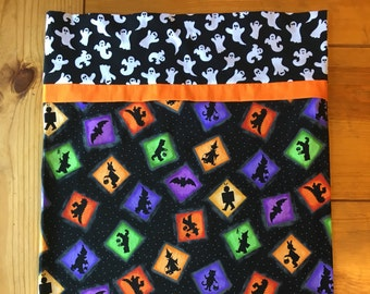 Handmade Halloween pillowcase with images of trick-or-treaters and friendly ghosts