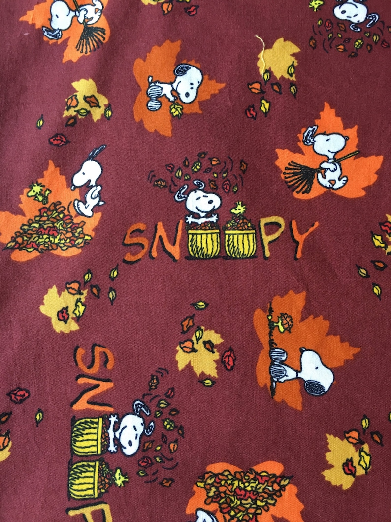 Handmade childrens pillowcase made from licensed Snoopy Charlie Brown fabric