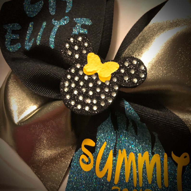 Ask me to design something for you today!! Cheer Bow Tick-Tock Bow Optional 3D Center Available SQUAD DISCOUNTS Squad Bows