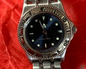 Ladies Citizen wristwatch, circular Dark Blue dial and date aperture