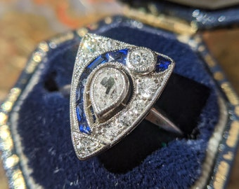 Vintage 1920s Art Deco Engagement Ring with a Pear Cut Diamond and Sapphire Accents set in Platinum, US Size 5