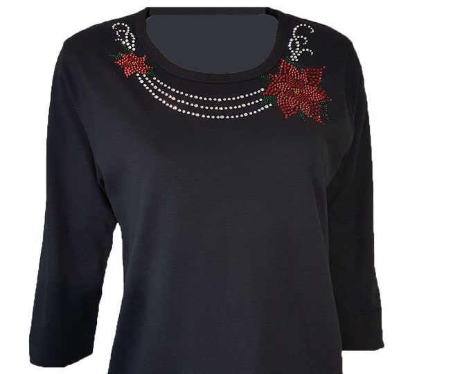 Poinsettia Bling Christmas Shirt with Rhinestone Embellishment. Soft flexible light weight design. Combed cotton poly blend.