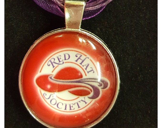 Red Hat Society Logo Necklace with Glass Cabochon Setting and Purple Ribbon and Cording Choker.