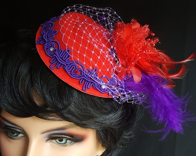 Red Hat Society Feathery Sophistication Fascinator Headband with Red Felt base, Purple Trim, Feathers, Silk Flower, Netting and Rhinestones.