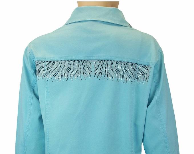 Zebra Bling stretch denim jacket aqua with long sleeves, pockets, and rhinestone embellishment.