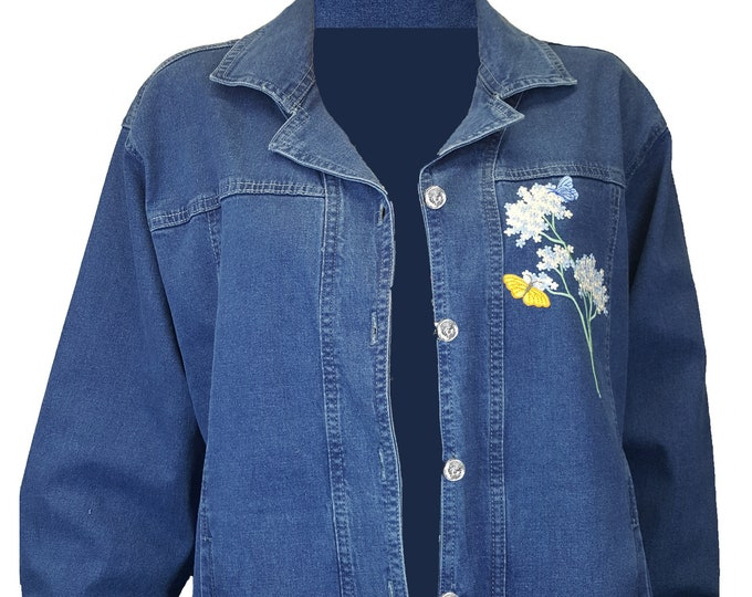Denim Jacket with Embroidered flowers and butterfly appliques. size lg designs on bottom