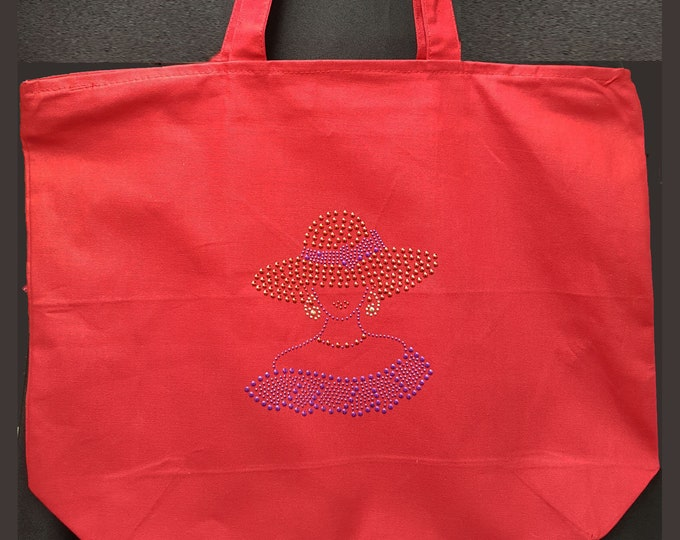 Red Hat Lady Rhinestud zippered  tote bag with inside zipper pocket.