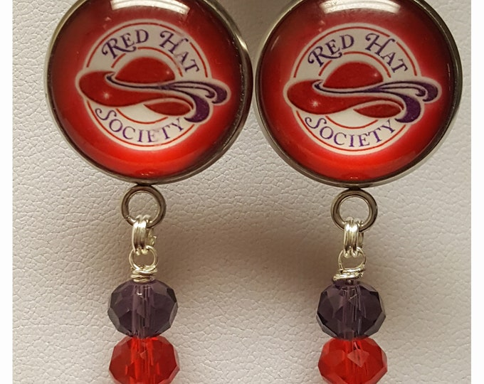 Red Hat Society Logo earrings with red and purple cut crystal dangle beads. Pierced or clip on.