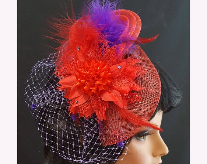 Red Hat Society Uptown Flair Fascinator with Red and Purple netting, Silk and satin flowers, Feathers, and Rhinestones.