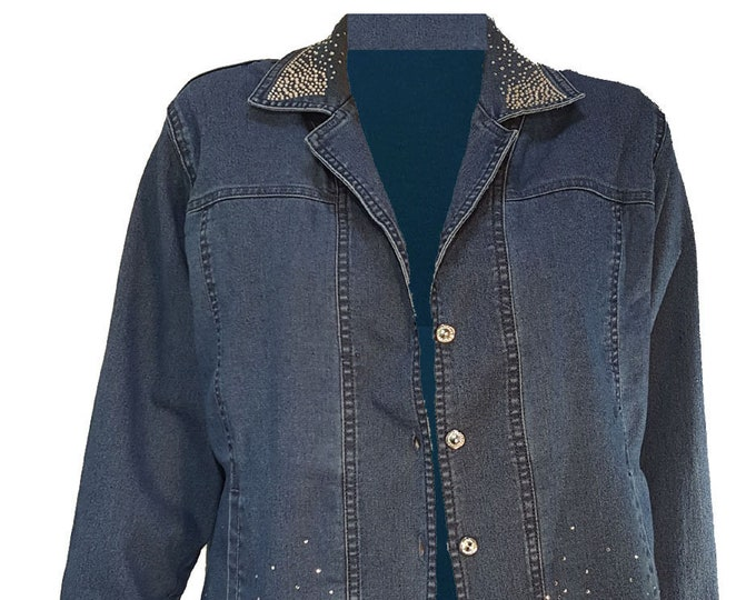 Denim bling Jacket long sleeves, pockets, and rhinestone buttons and embellishment. Cotton spandex fabric for comfort.