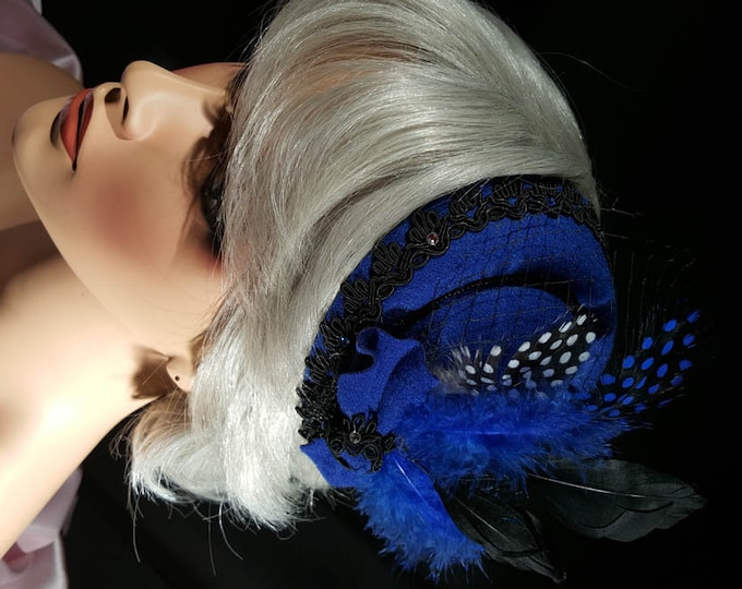 Dramatic Blue Fascinator feather hat with black fur narrow trim, flower with beaded feathers or bow ,Czech crystals and dotted netting.