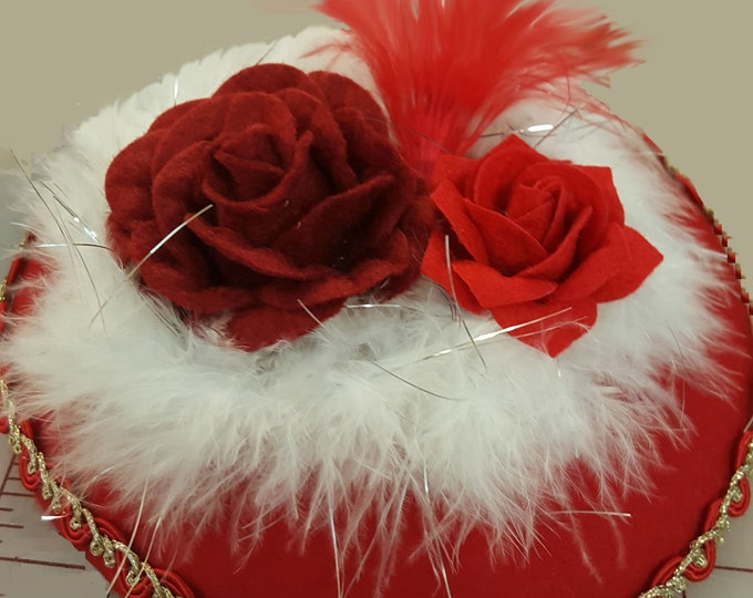 Red Beret wool hat headband with Red and Gold scroll trim, white boa with Felt roses, and accented with red feathers.