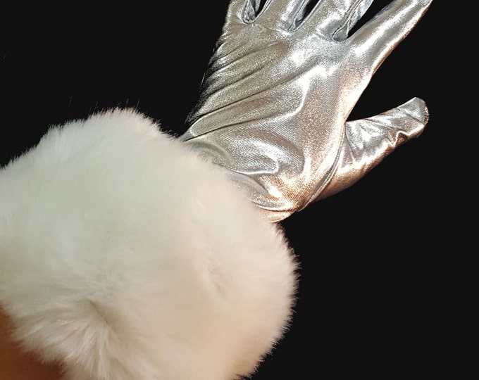 Silver gloves with faux fur cuffs. Ladies size Med-lg size.