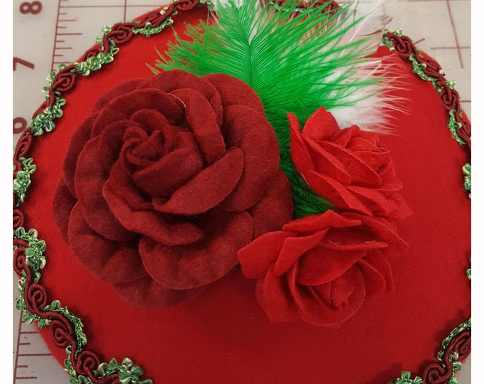 Red Beret wool hat headband with Red and Green trim, Felt roses, and accented with feathers.